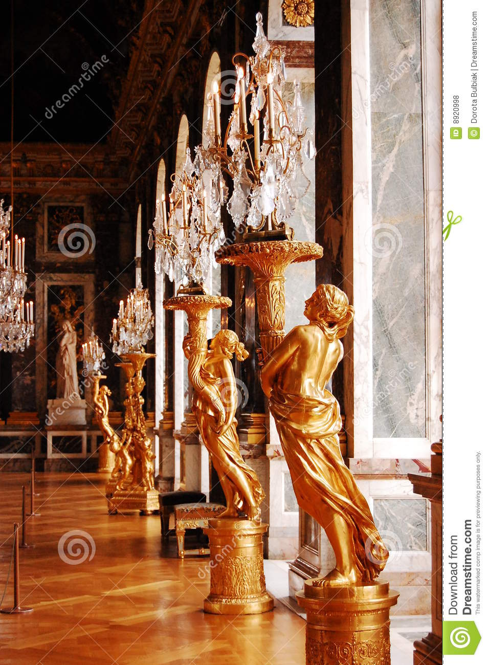 Crystal Chandeliers And Gold Statues In Versailles