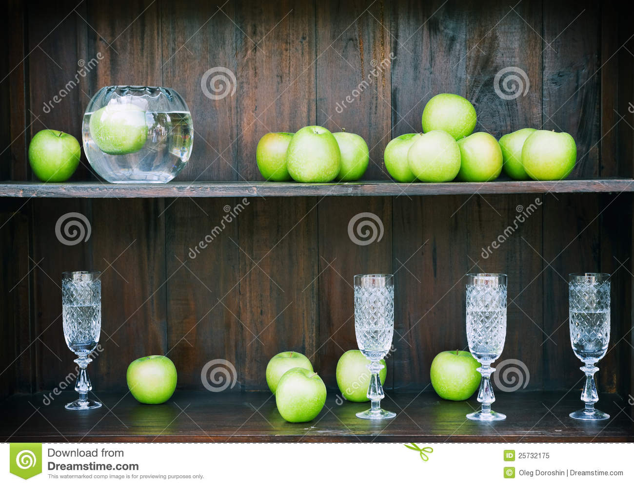Crystal glasses and green apples
