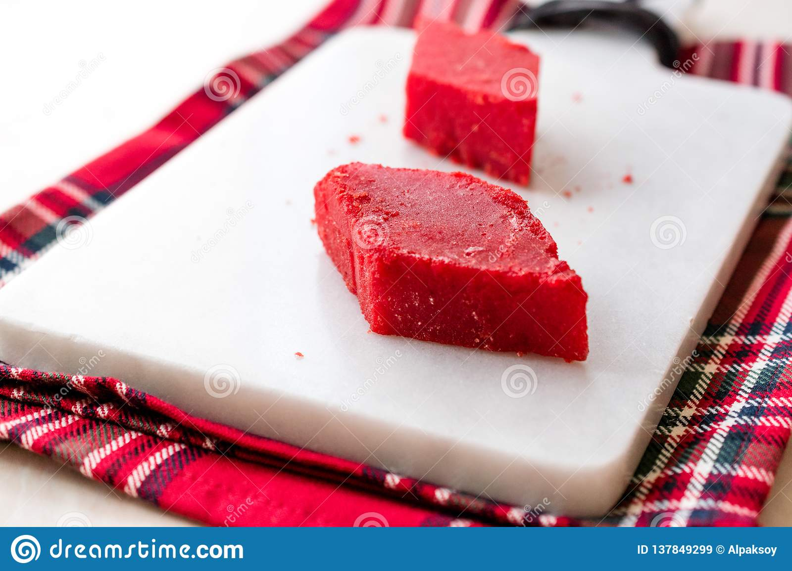 Crystallized Turkish Delight Red Sugar. Crystal Confectionery Nobet Sekeri on White Marble Surface.