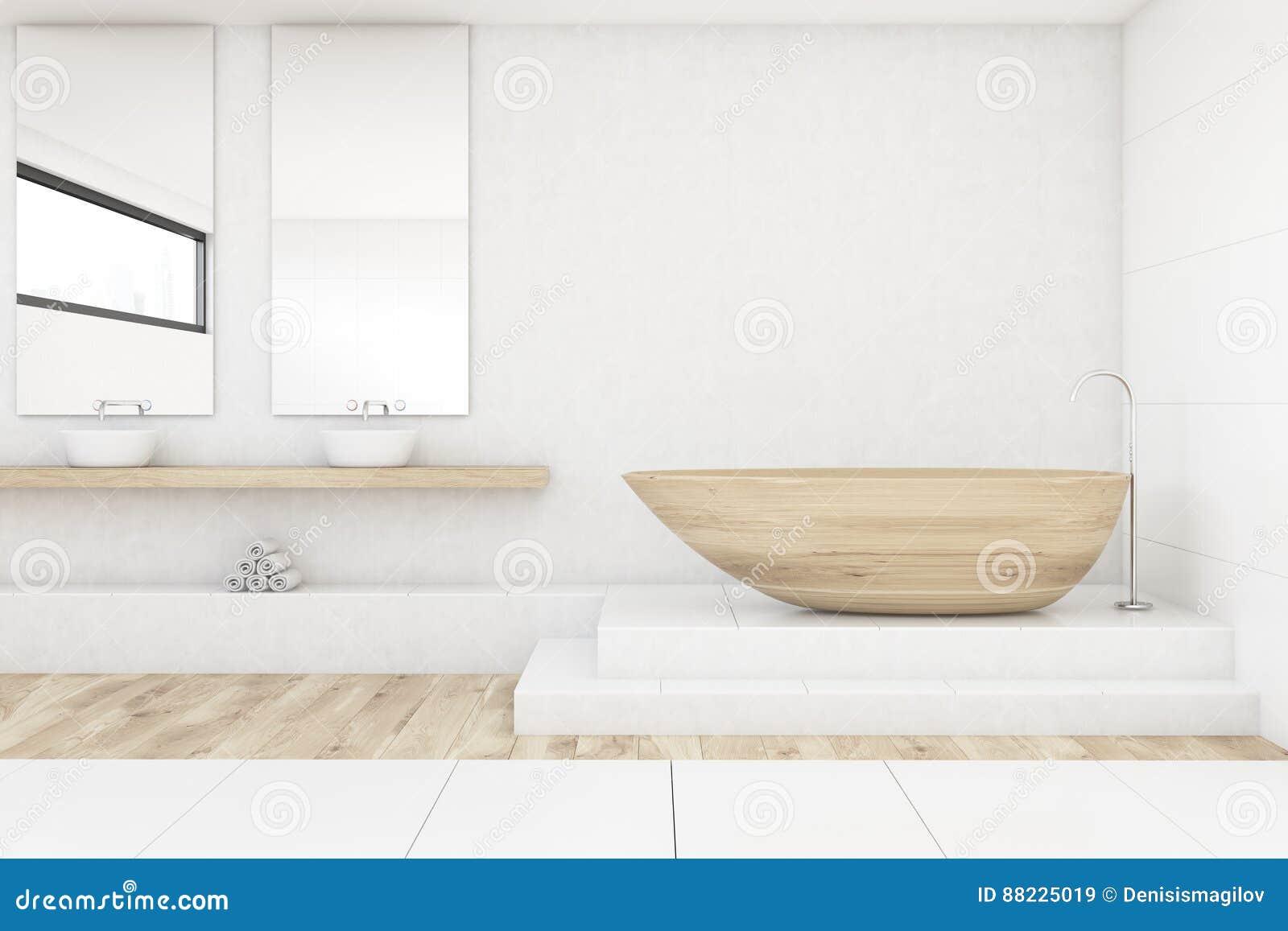 cuarto de bao con dos espejos maderas y blancos