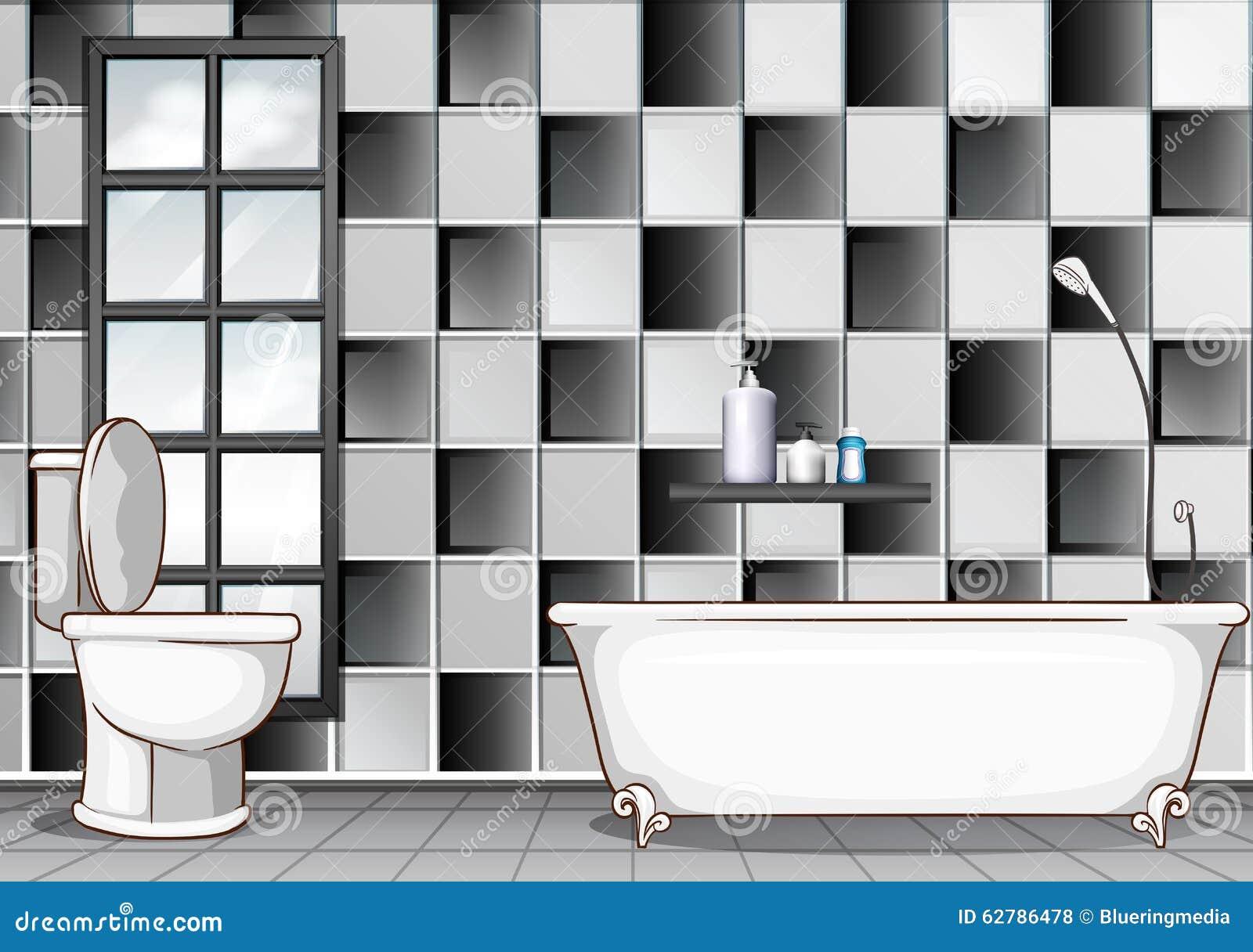 cuarto de bao con los azulejos blancos y negros