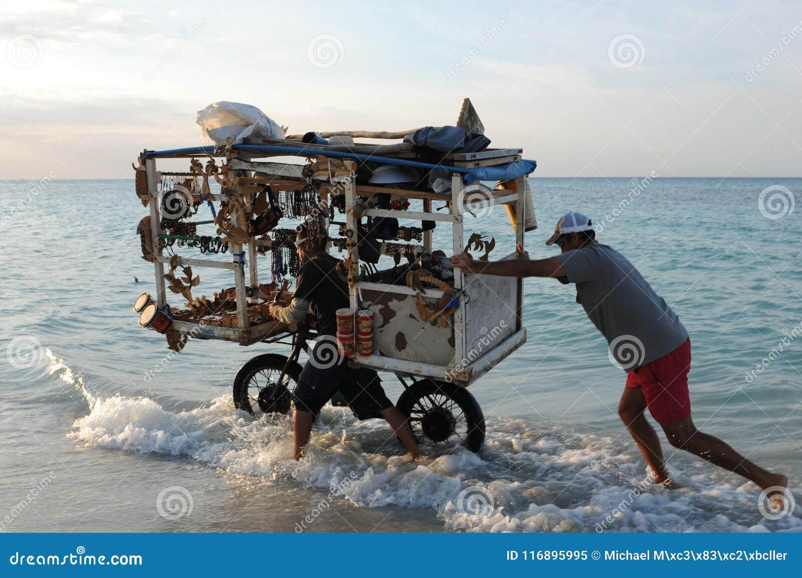 Cuba: Beach souvenier trader at Varadero beach.