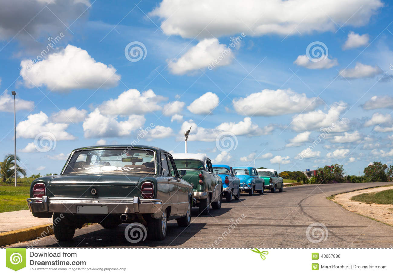 Cuba Classic Cars Lined Up Drived On The Road Stock Photo