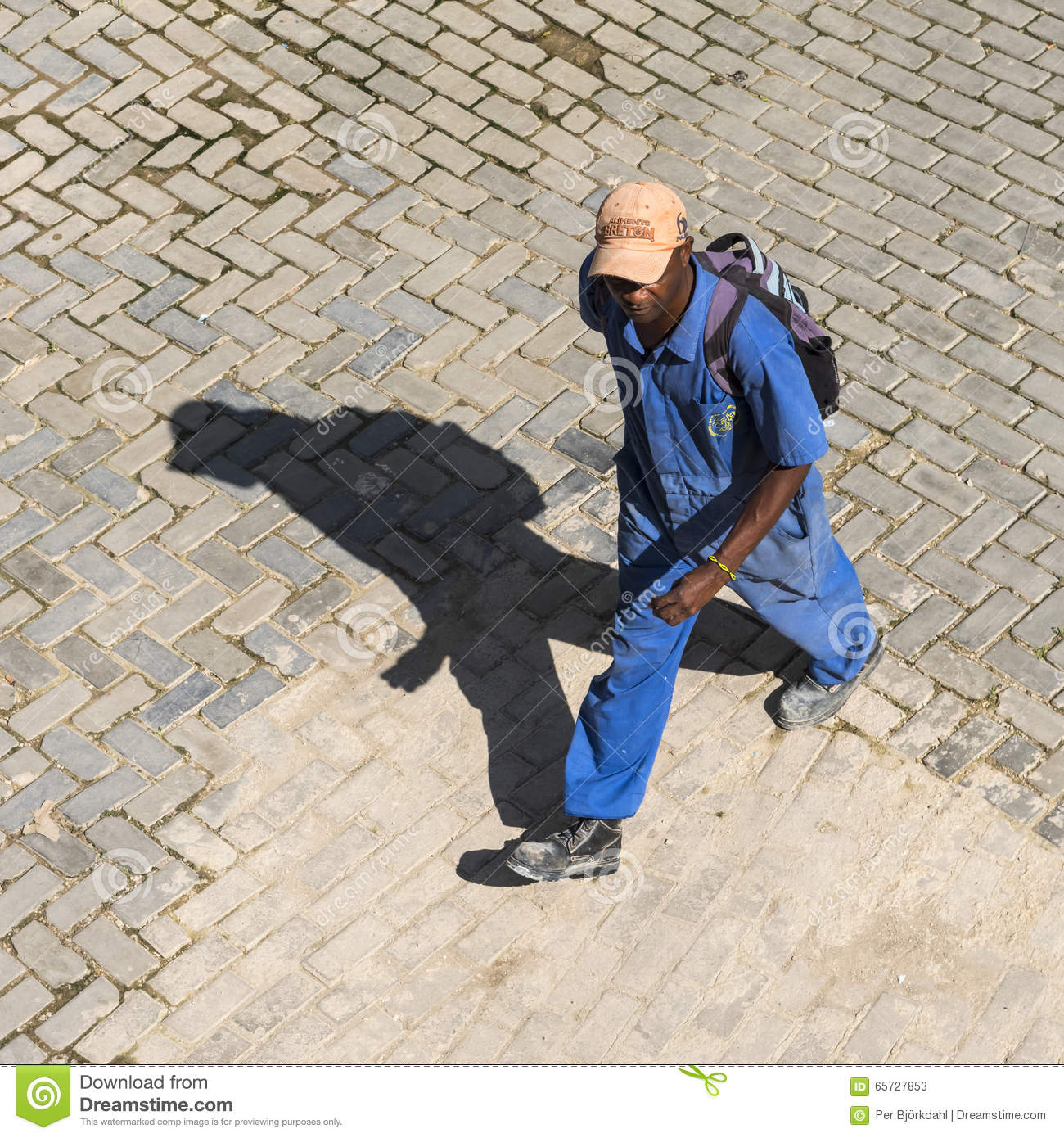 Cuban worker on his way to work