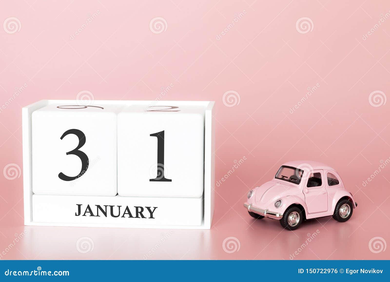 Cubo di legno del primo piano il trentunesimo gennaio Giorno 31 del mese di gennaio, calendario su un rosa