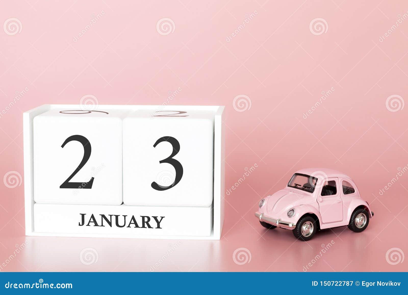 Cubo di legno del primo piano il ventitreesimo gennaio Giorno 23 del mese di gennaio, calendario su un rosa
