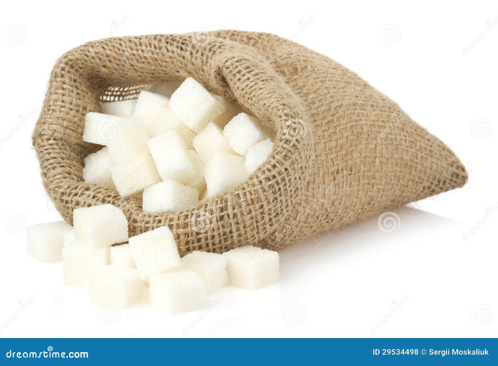 Cubos do açúcar no saco do saco