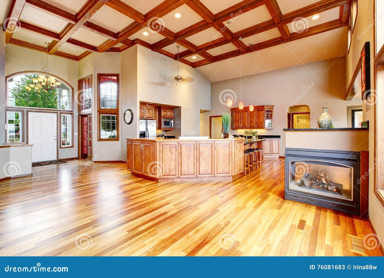 Cucina e salone con il pavimento di legno duro porta di entrata bianca immagine stock - Cucina bianca e legno ...