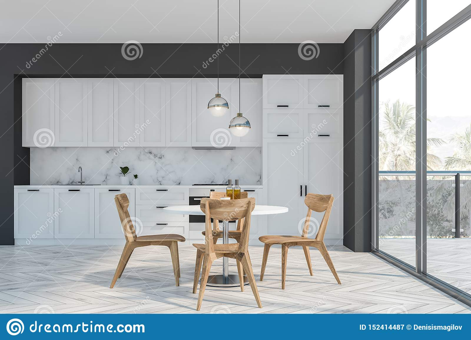Cucina grigia e bianca con il balcone e la tavola