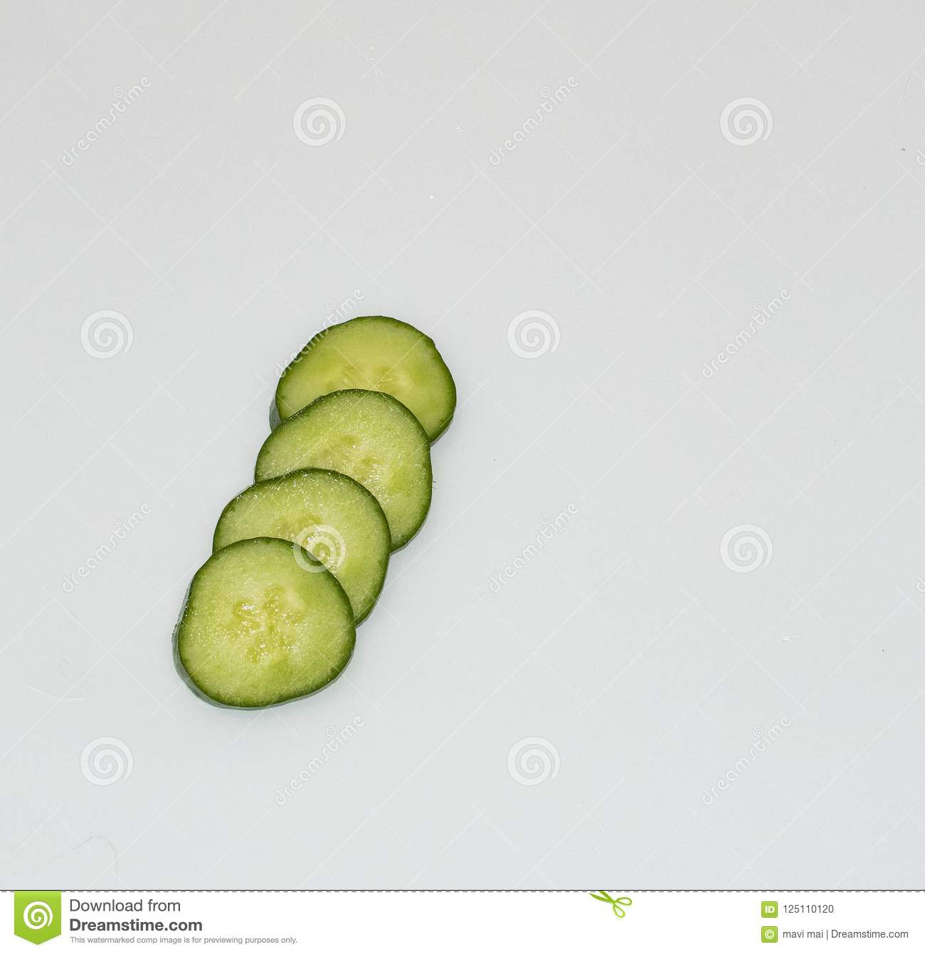 Cucumber and slices over white background