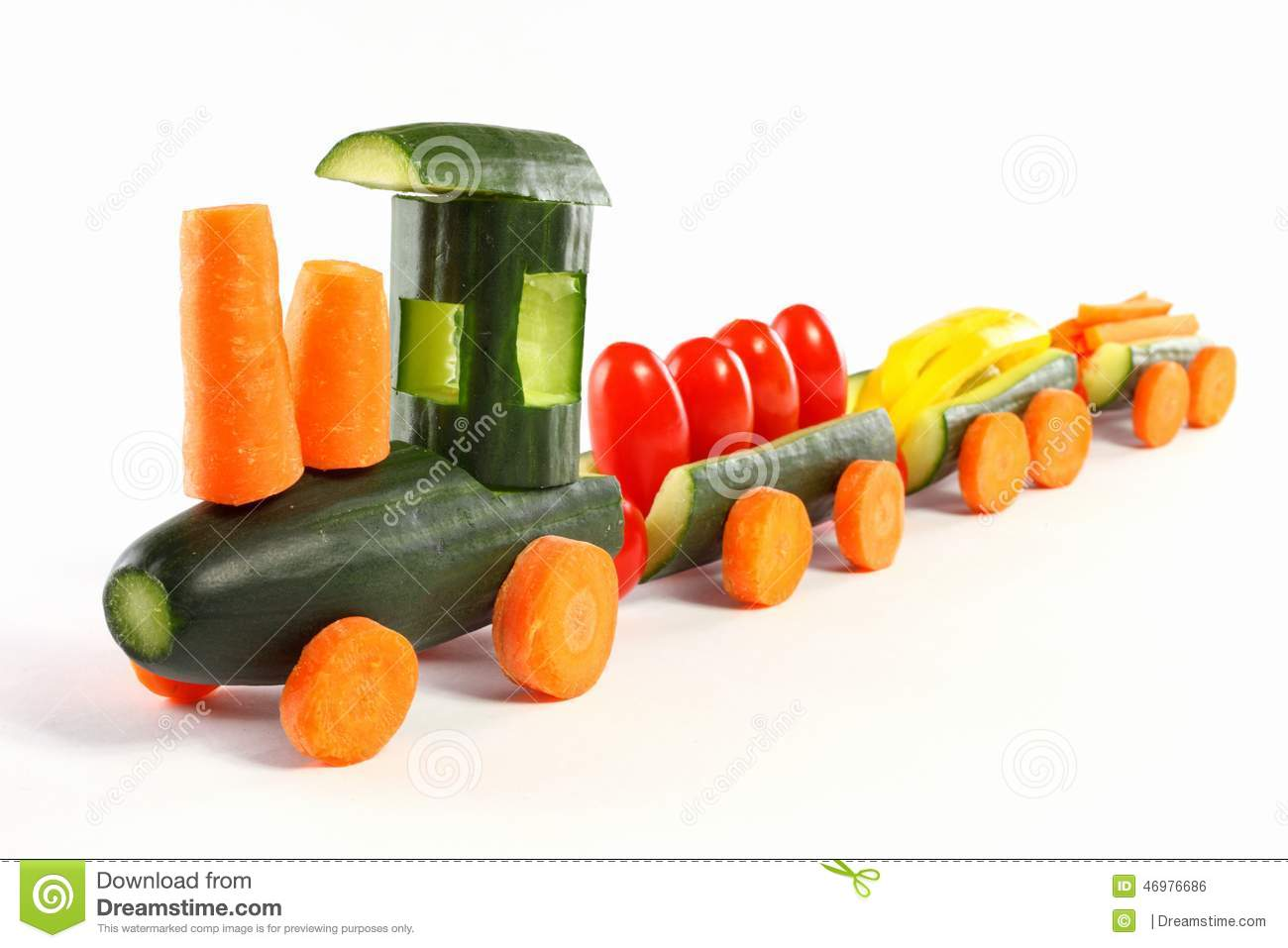 From cucumbers and other vegetables carved train-isolated.