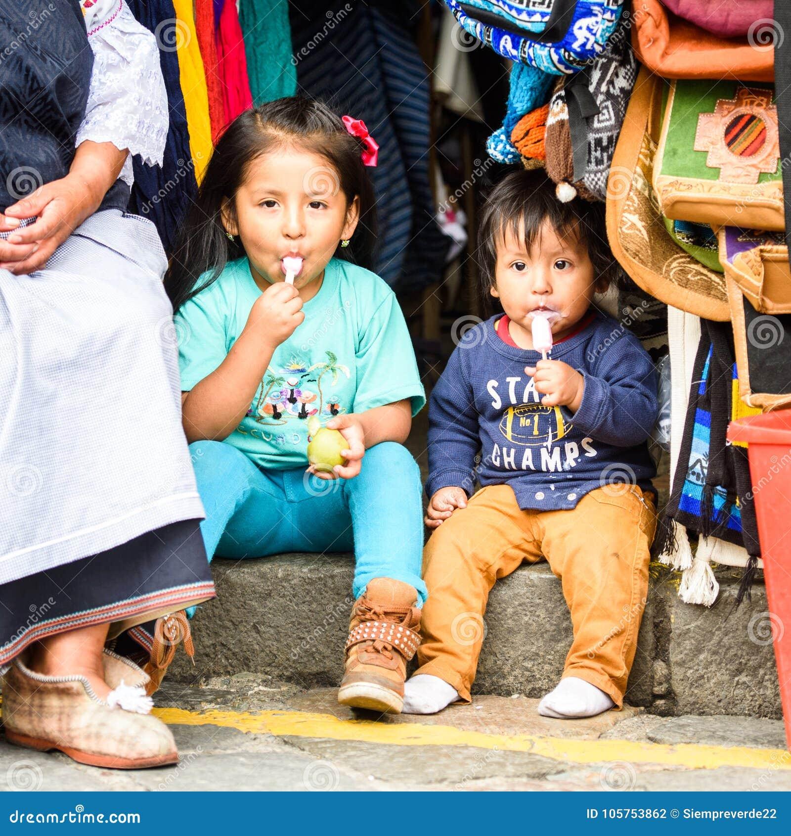 Cuenca ecuador jan 9 2015 unidentified ecuadorian children sit at the market 719 of ecuadorian people belong to the mestizo ethnic group