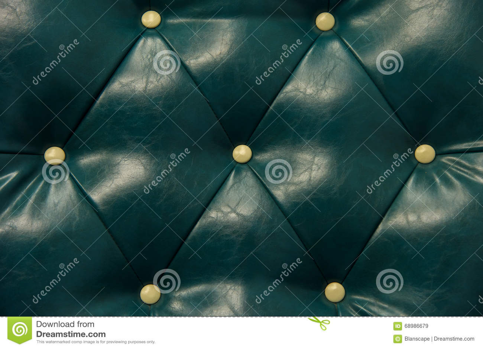 Cuero y sofá verdes antiguos del botón