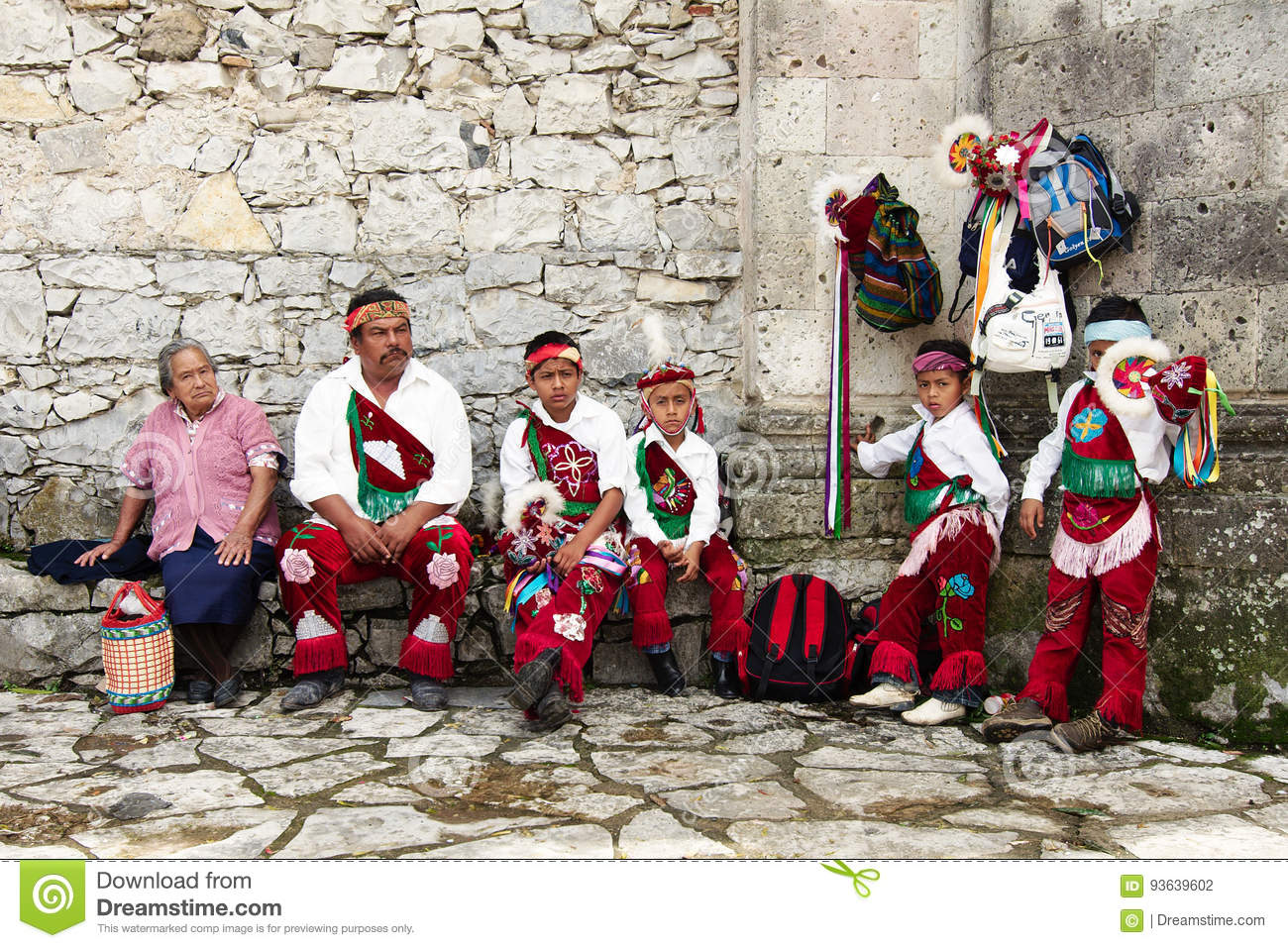 CUETZALAN, MEXICO - 2012: A family of acrobats known as `los voladores` prepare to perform in the Cuetzalan zocalo, while standing
