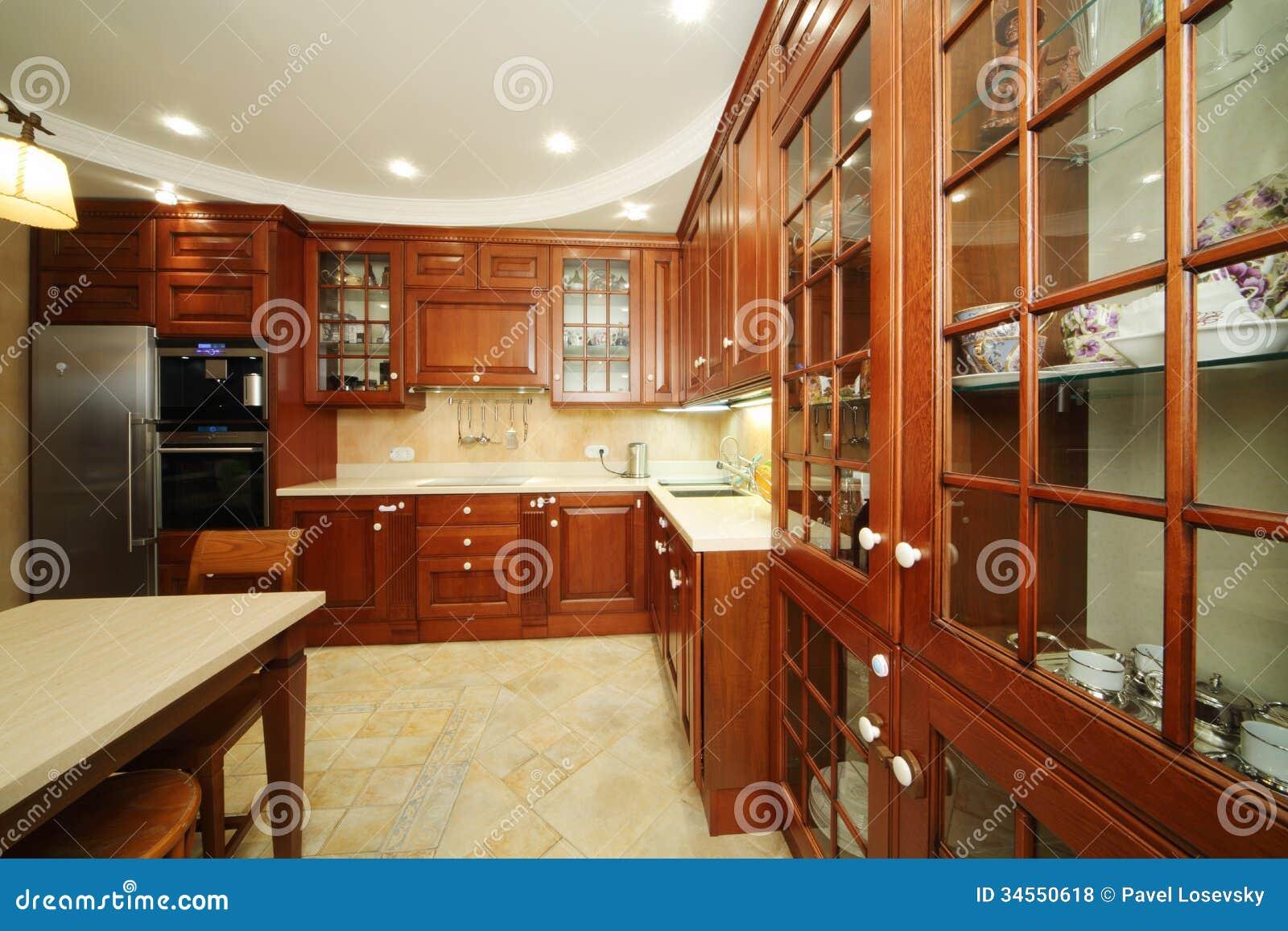 Cuisine avec les meubles en bois photo stock image 34550618 for Porte de meuble de cuisine en bois