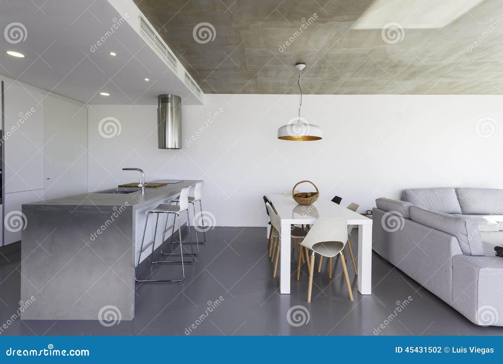Cuisine Moderne Avec Le Plancher Gris Et Le Mur Blanc Photo stock ...