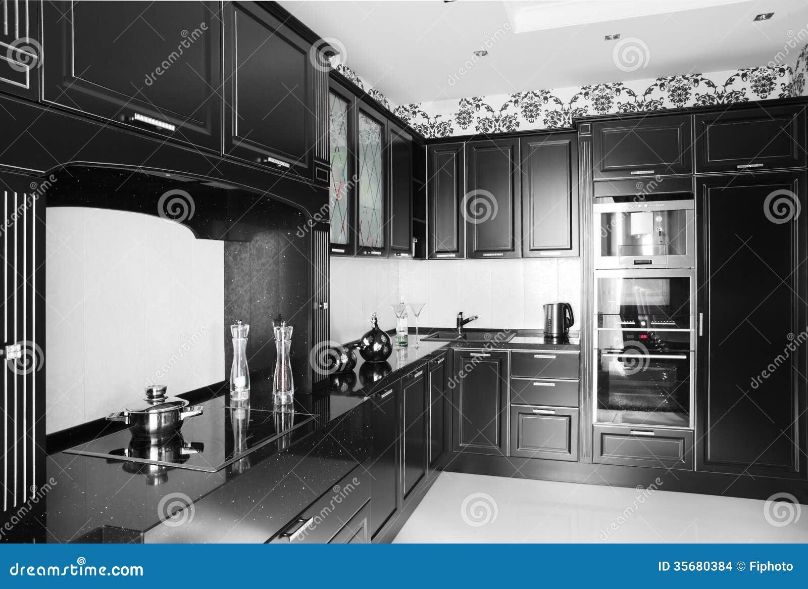 Cuisine moderne noire et blanche avec les meubles l gants for Cuisine a et e