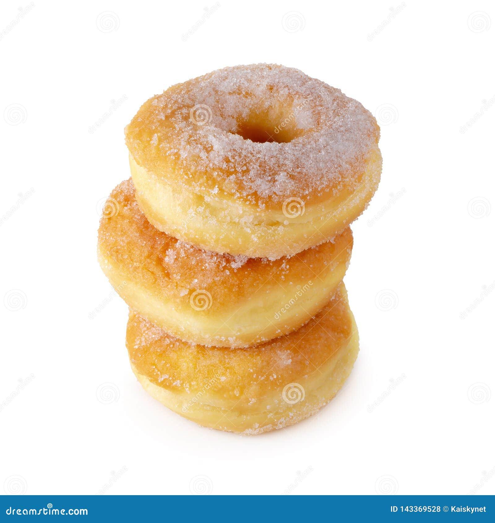 Cukierkowi donuts odizolowywający nad białym tłem