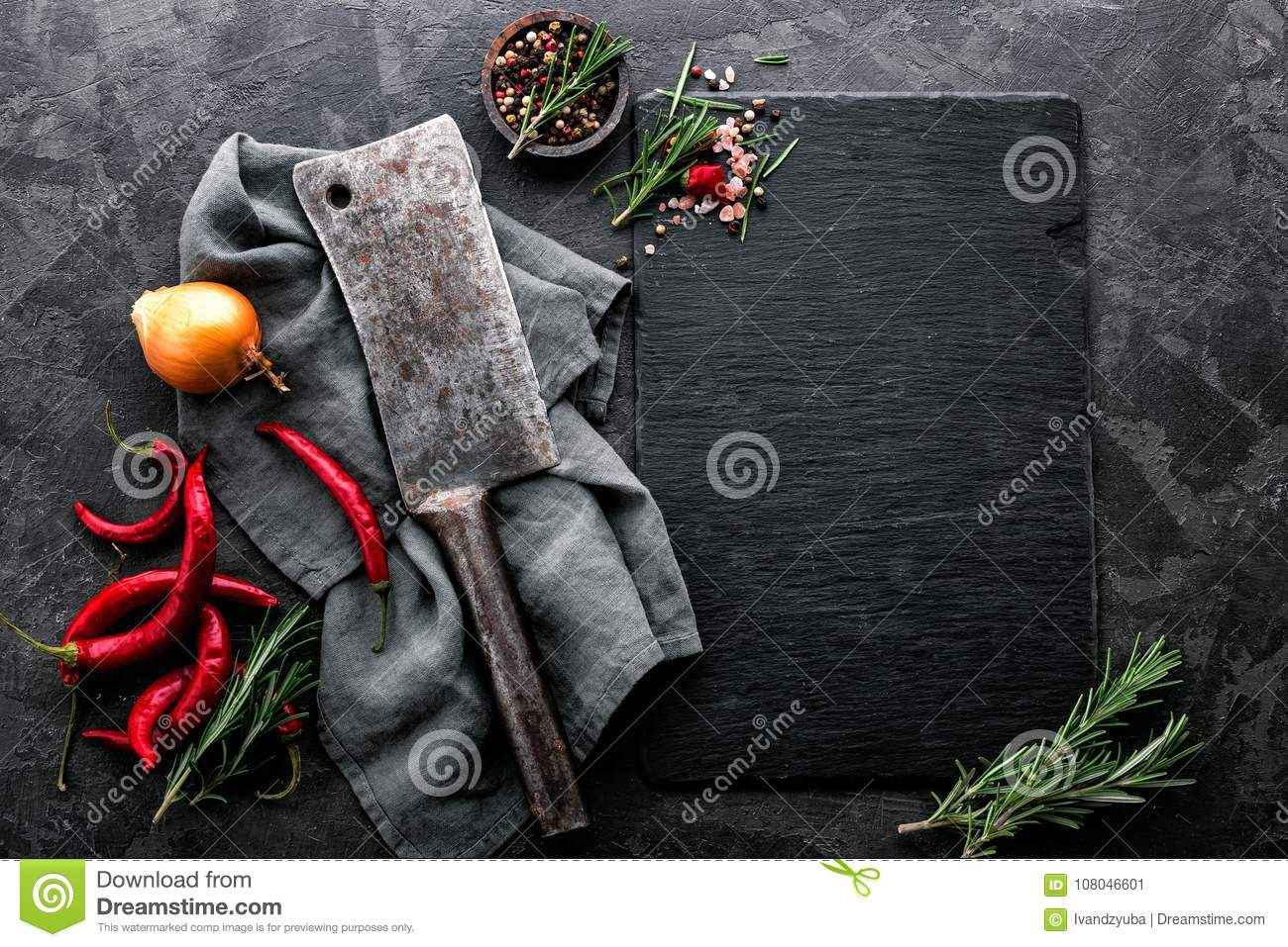 Culinary background with empty black slate board