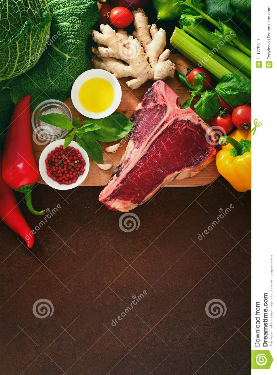 Culinary background with fresh vegetables and meat
