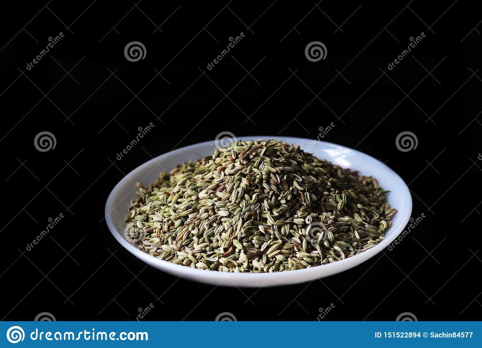 Cumin seeds isolated on a black background - image
