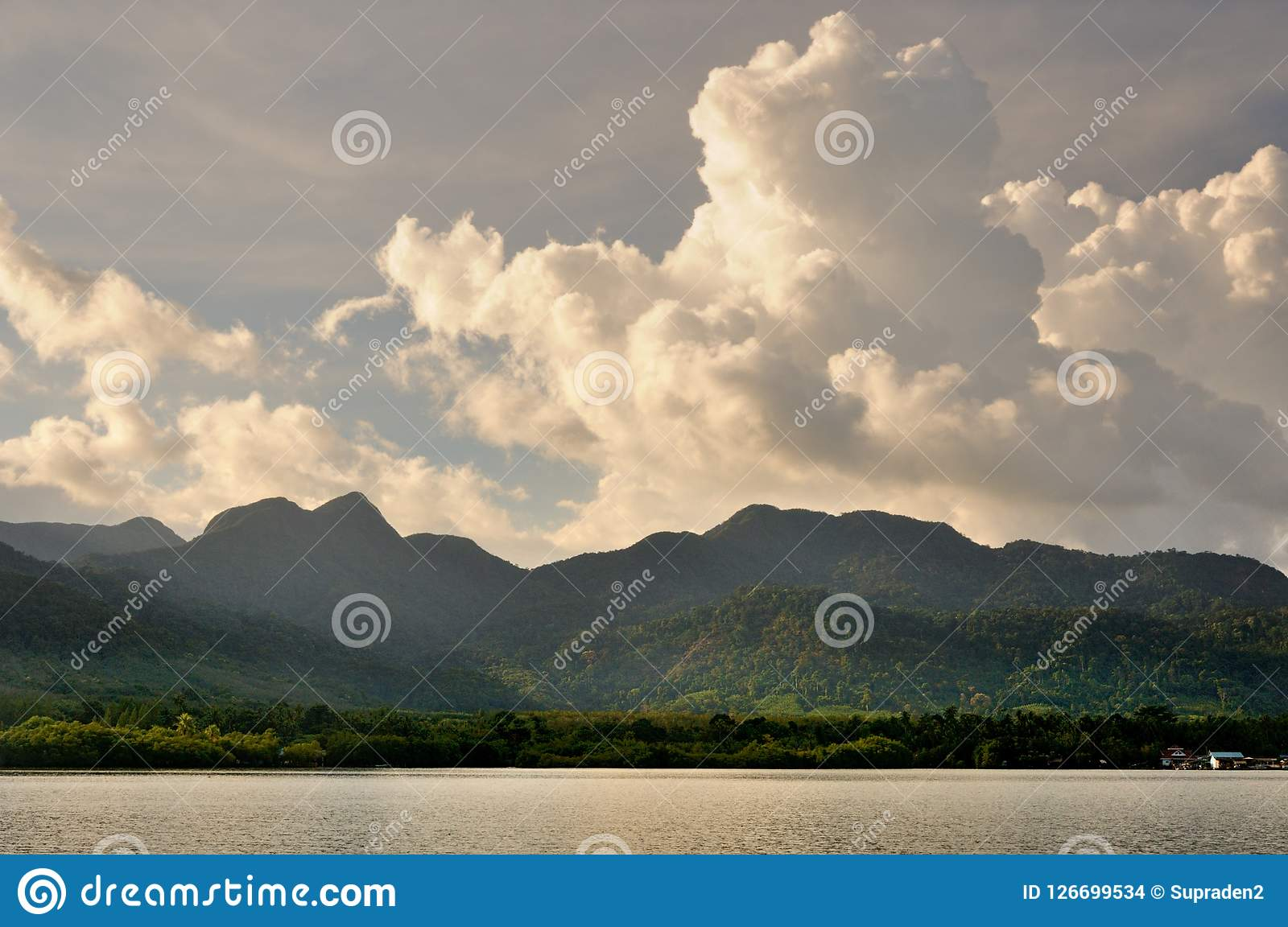 Cumulus clouds in sunset sky over Koh Chang island, Thailand.