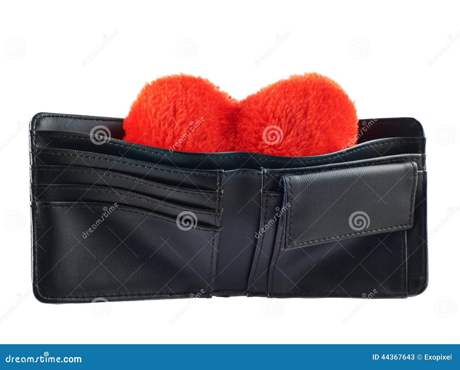 Cuore della peluche in un portafoglio isolato