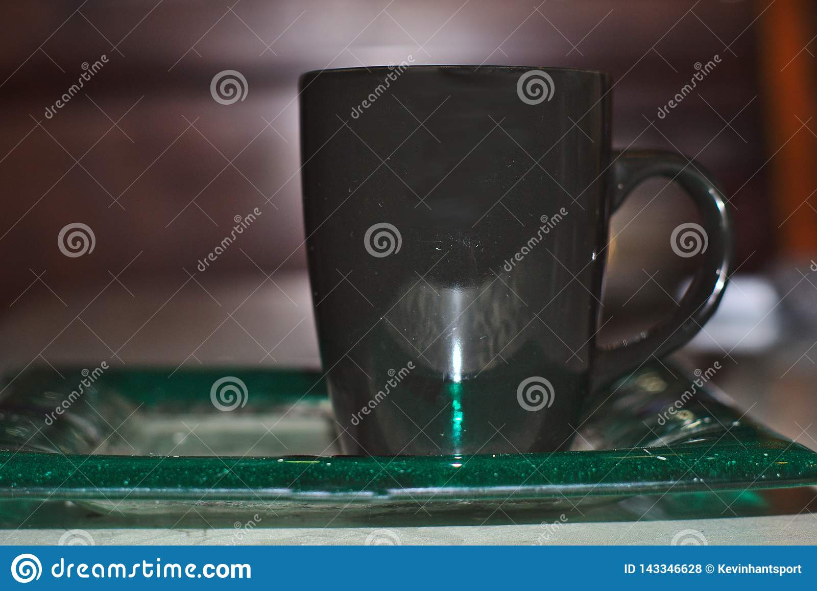 Cup on antique plate