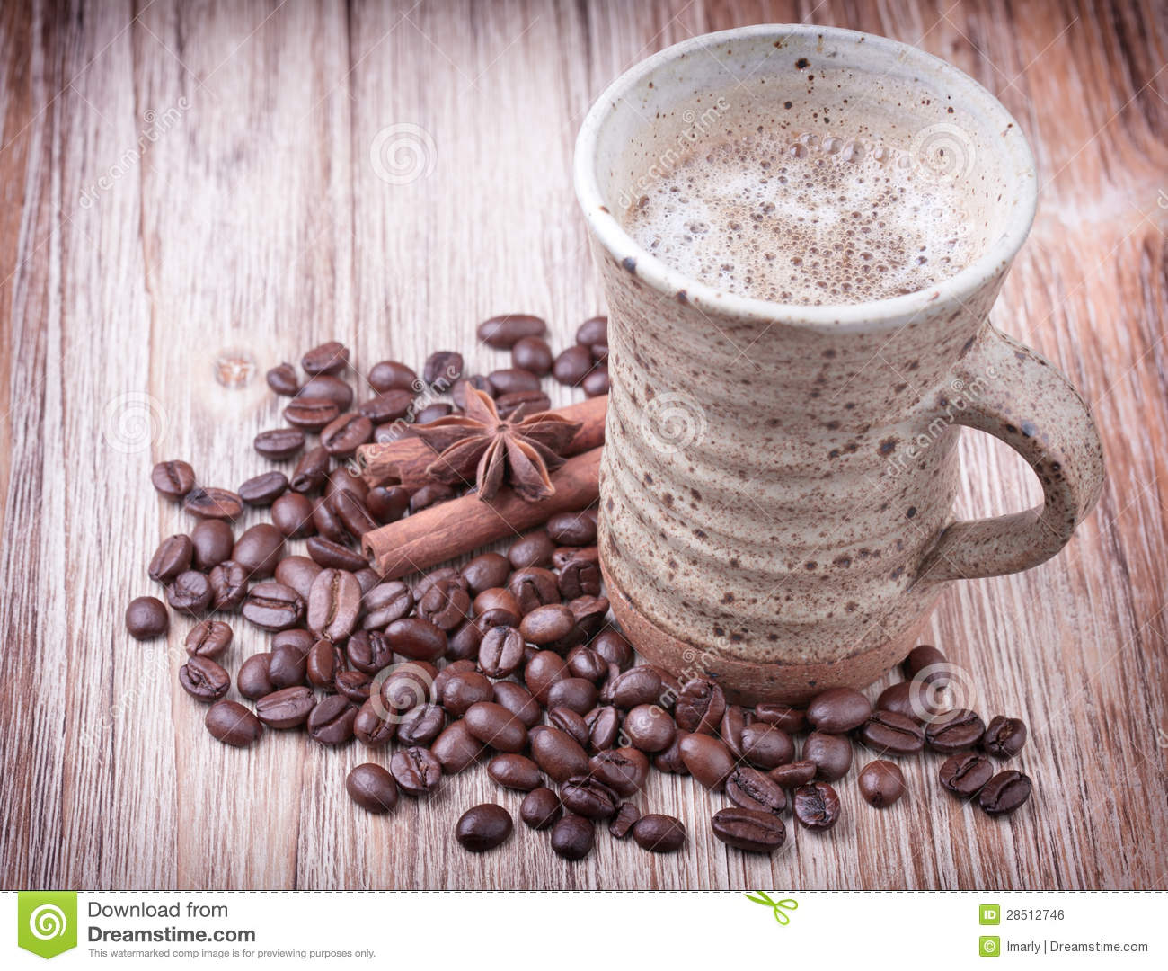 Cup of black coffee, cinnamon, aniseed and roasted coffee beans