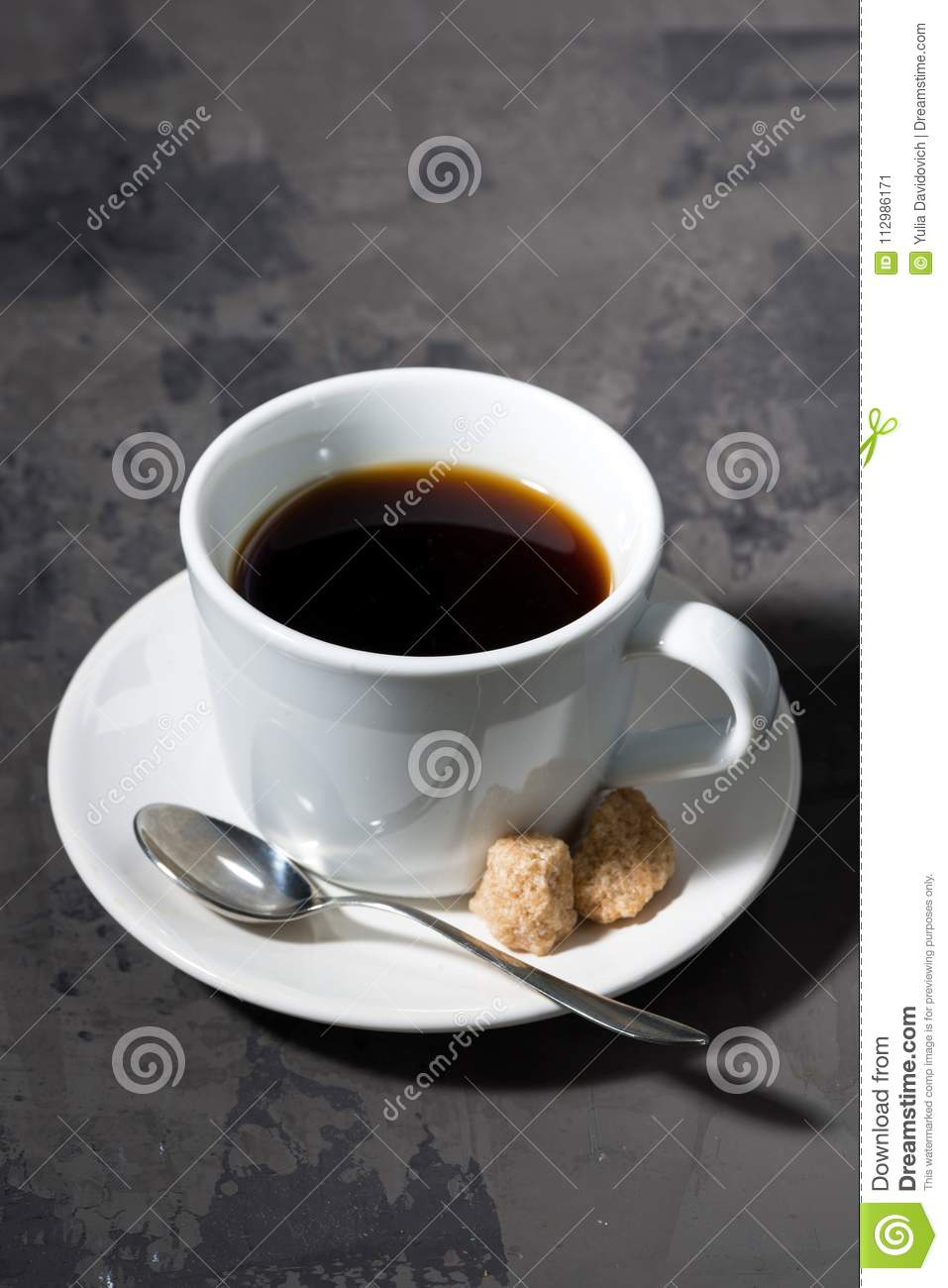 Cup of black coffee on a dark background, vertical