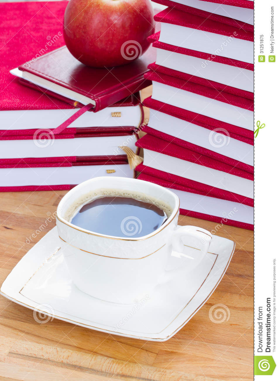 Cup of black coffee on table with books royalty free stock for Apple coffee table book