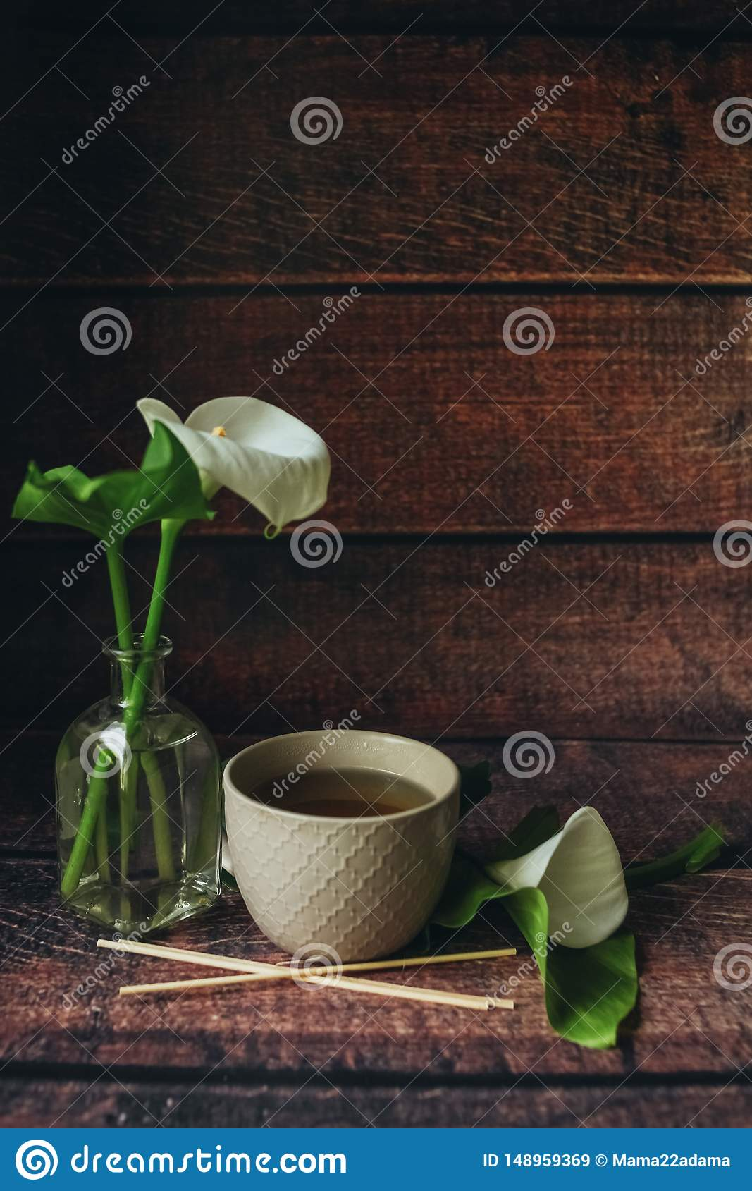 Cup of black tea on thewooden background