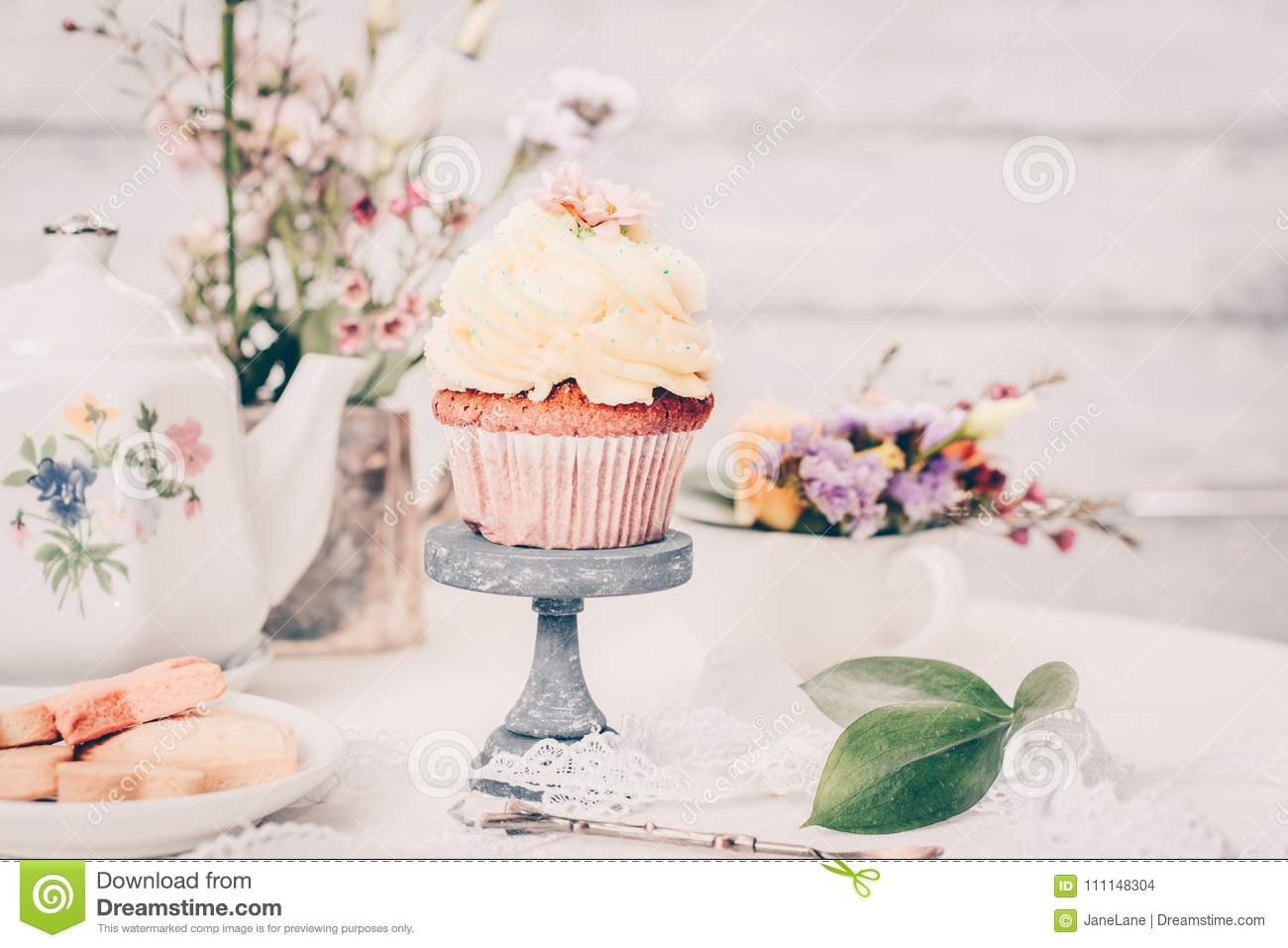 Cup Cakes With Cream Cheese Topping On Beautiful Wooden Cake Sta