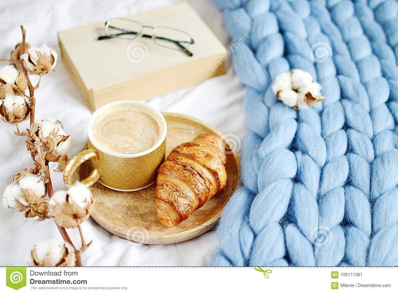 Cup with cappuccino, croissant, blue pastel giant plaid