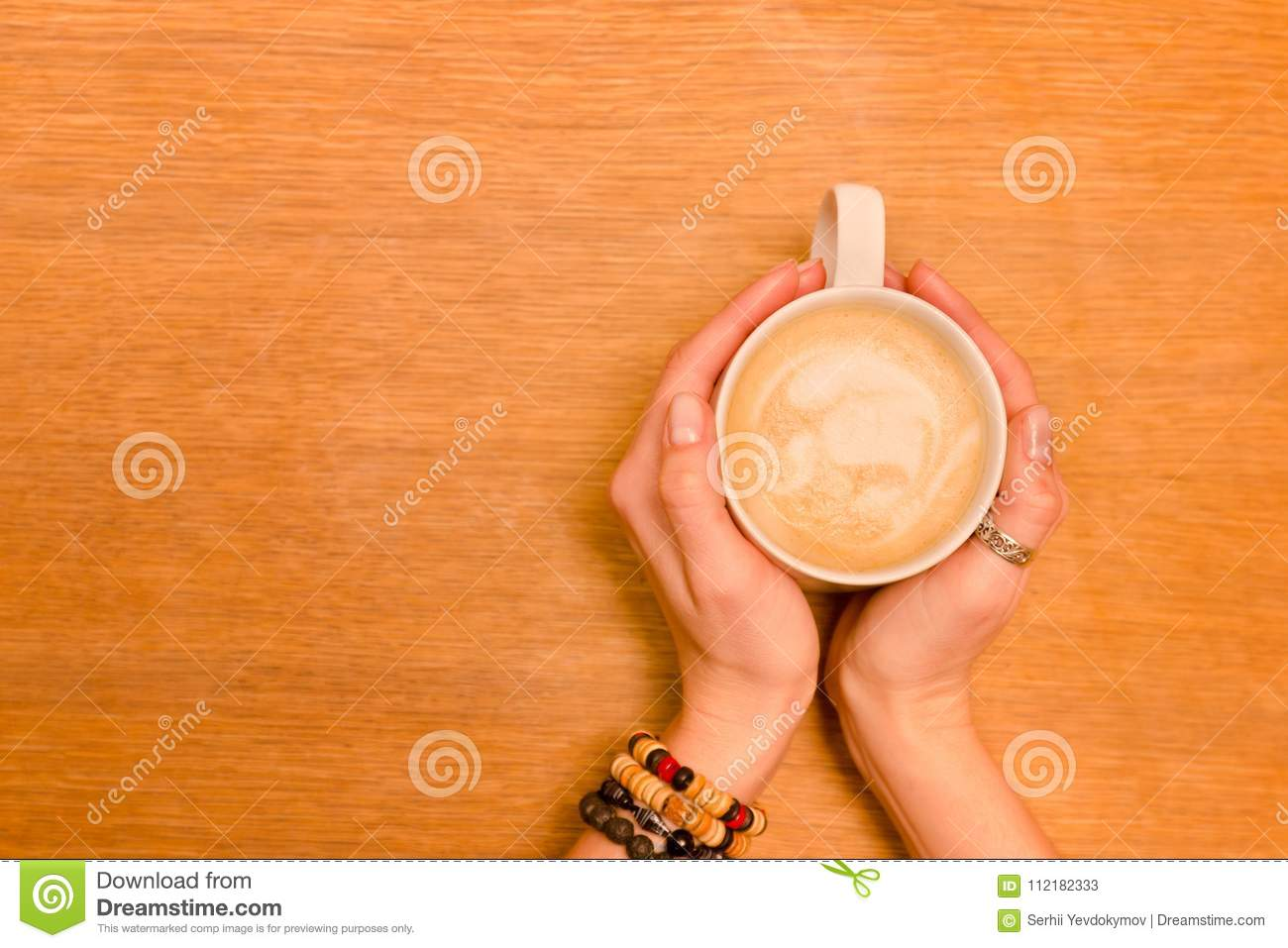 Cup Of Cappuccino In Female Hands. Wooden Table, Copy ...