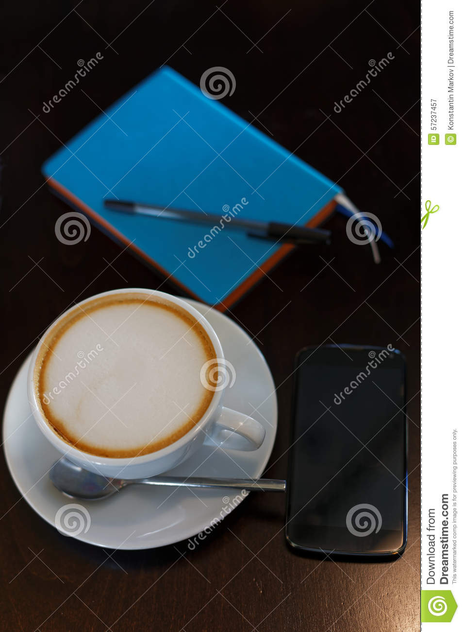 Cup Of Cappuccino Smartphone And Notebook With Pen On The