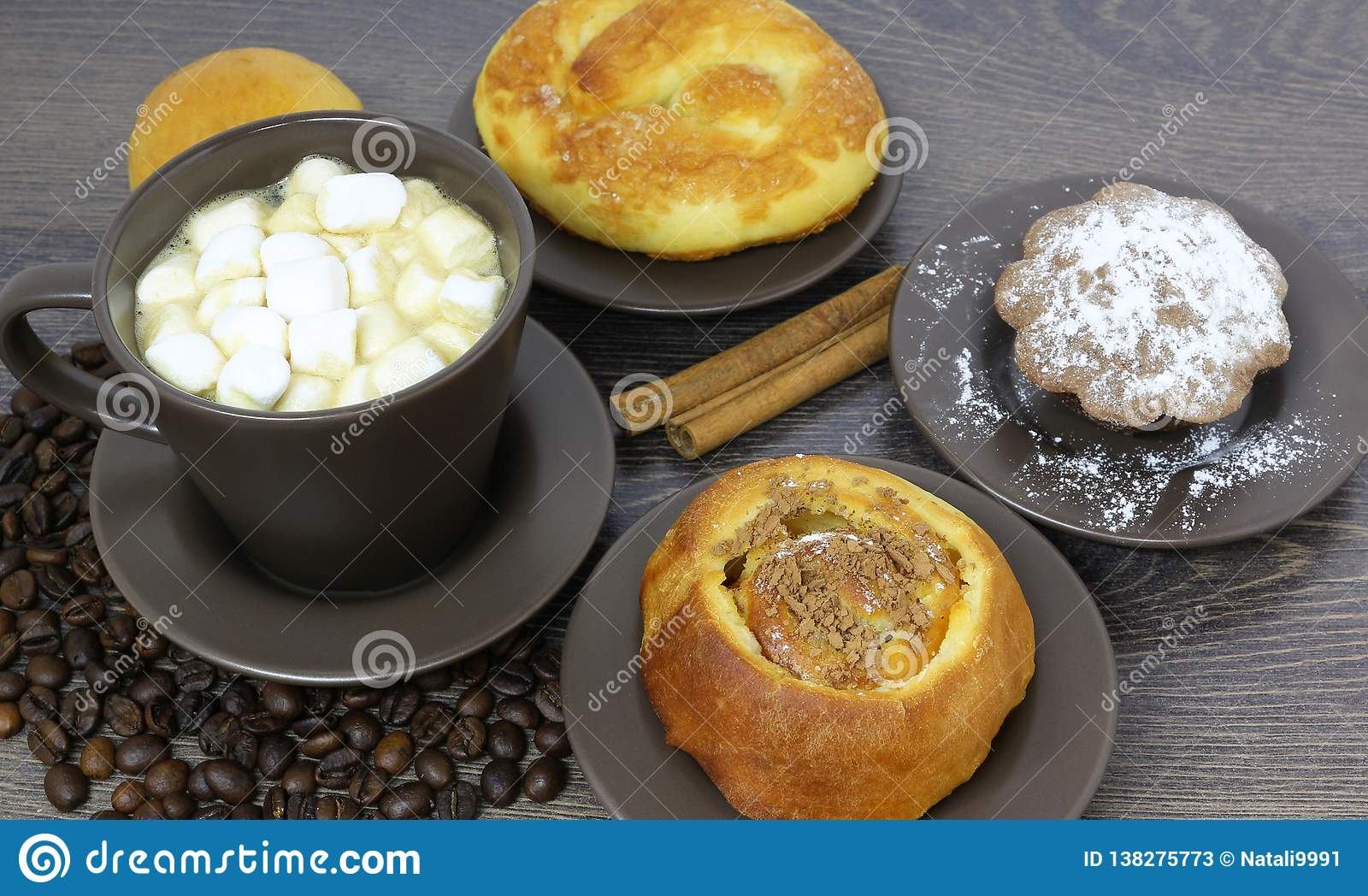 Cup of coffee with beans and marshmallow
