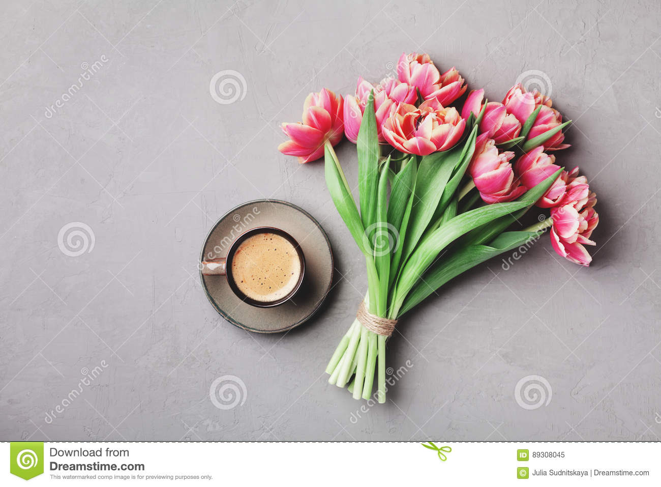 Cup of coffee with beautiful pink flowers for good morning on gray royalty free stock photo download cup of coffee with beautiful pink flowers for good morning izmirmasajfo