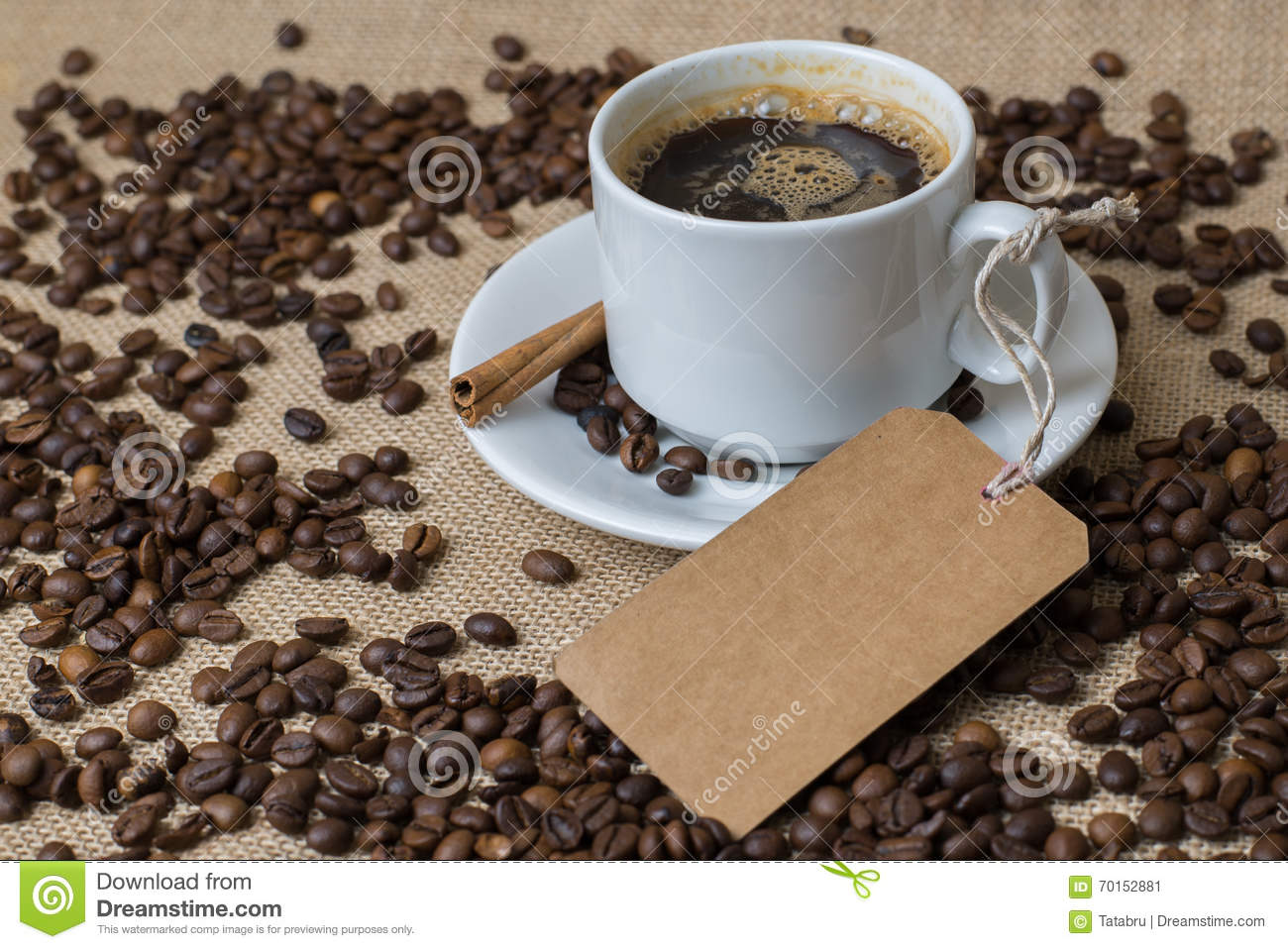 A Cup of coffee with coffee beans and label