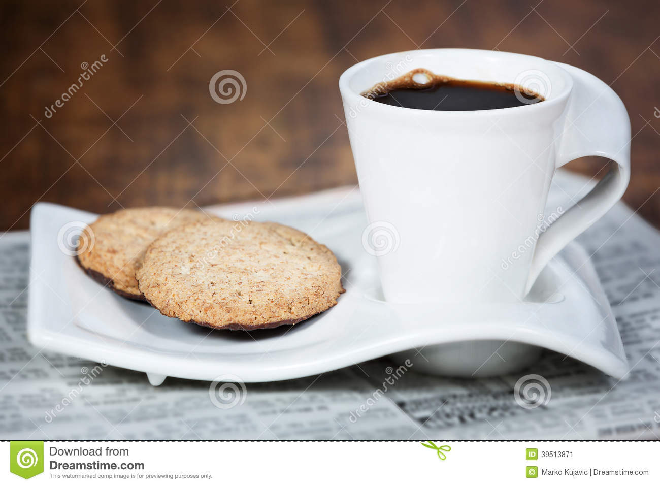 Cup of coffee and a cookie.
