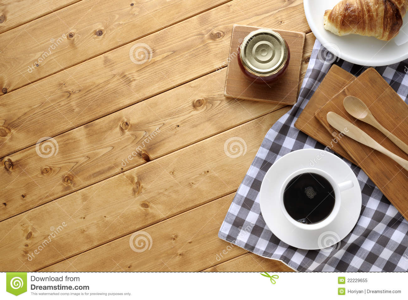 a cup of coffee with croissant on wooden table royalty free stock photo image 22229655. Black Bedroom Furniture Sets. Home Design Ideas