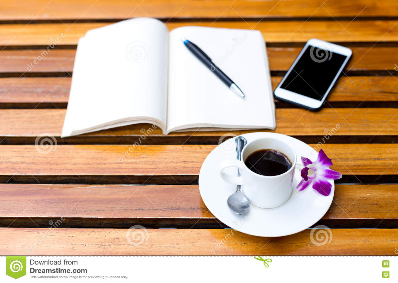 Coffee Cup Smart Phone And Note Book On Wooden Table