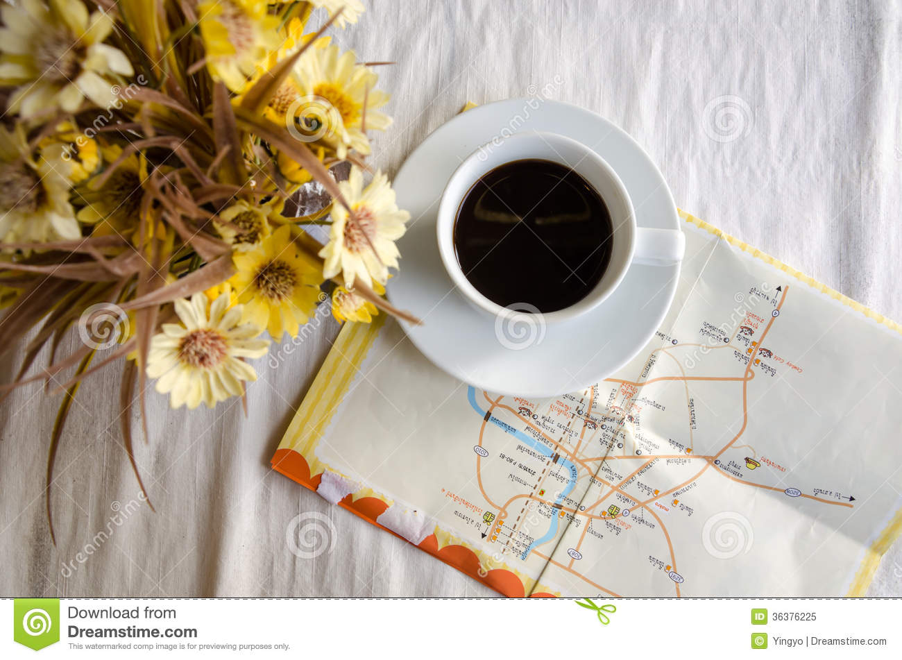 Cup Of Coffee Flower Pot And Map On Table Royalty Free