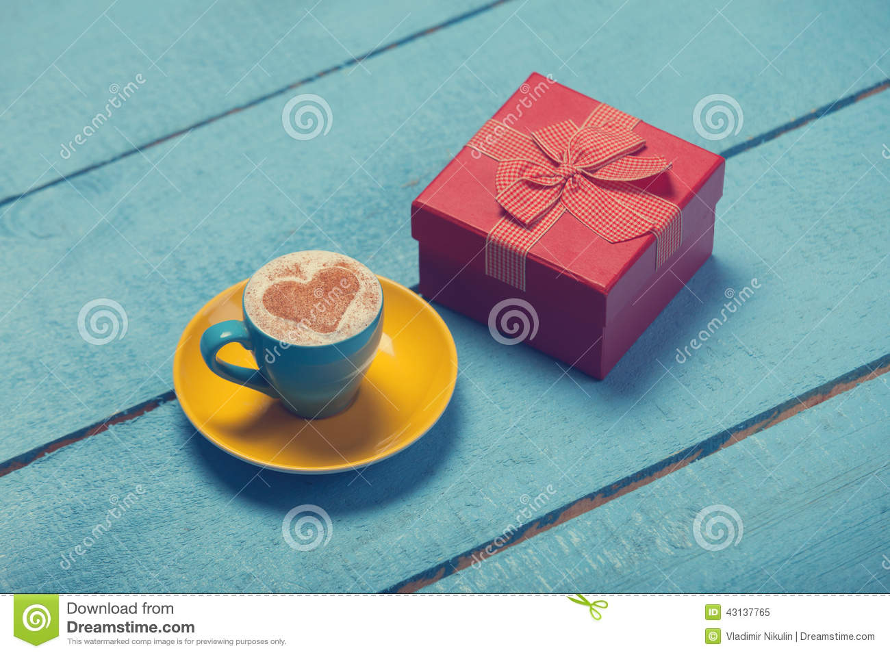 Cup of coffee and gift