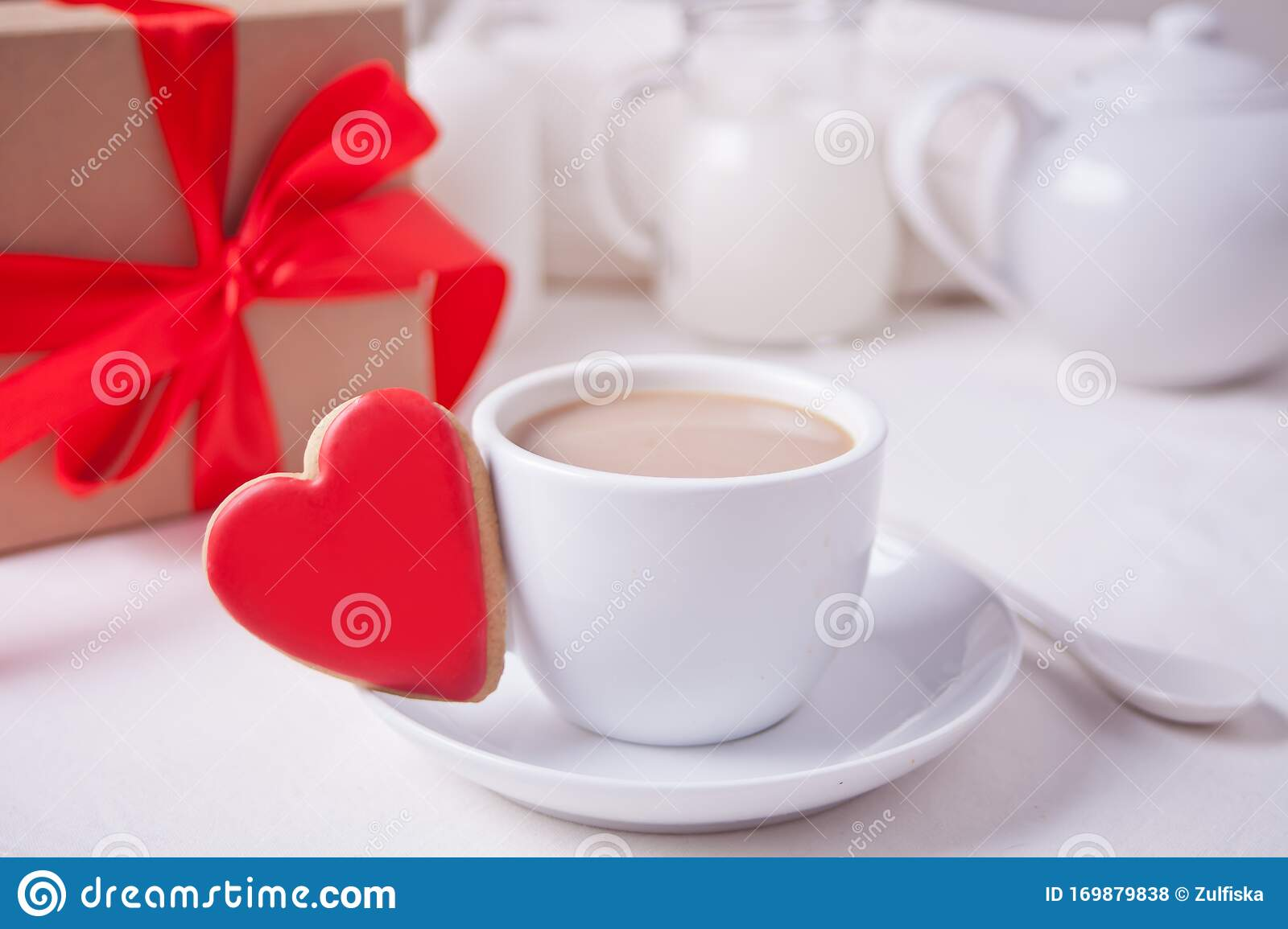 Cup Of Coffee And A Heart Shaped Red Cookie With Gift Box And Teapot On The White Table Stock Photo Image Of Cookies Cafe 169879838