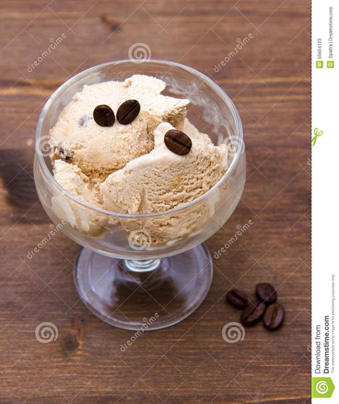 Cup of coffee ice cream on wood from above stock image