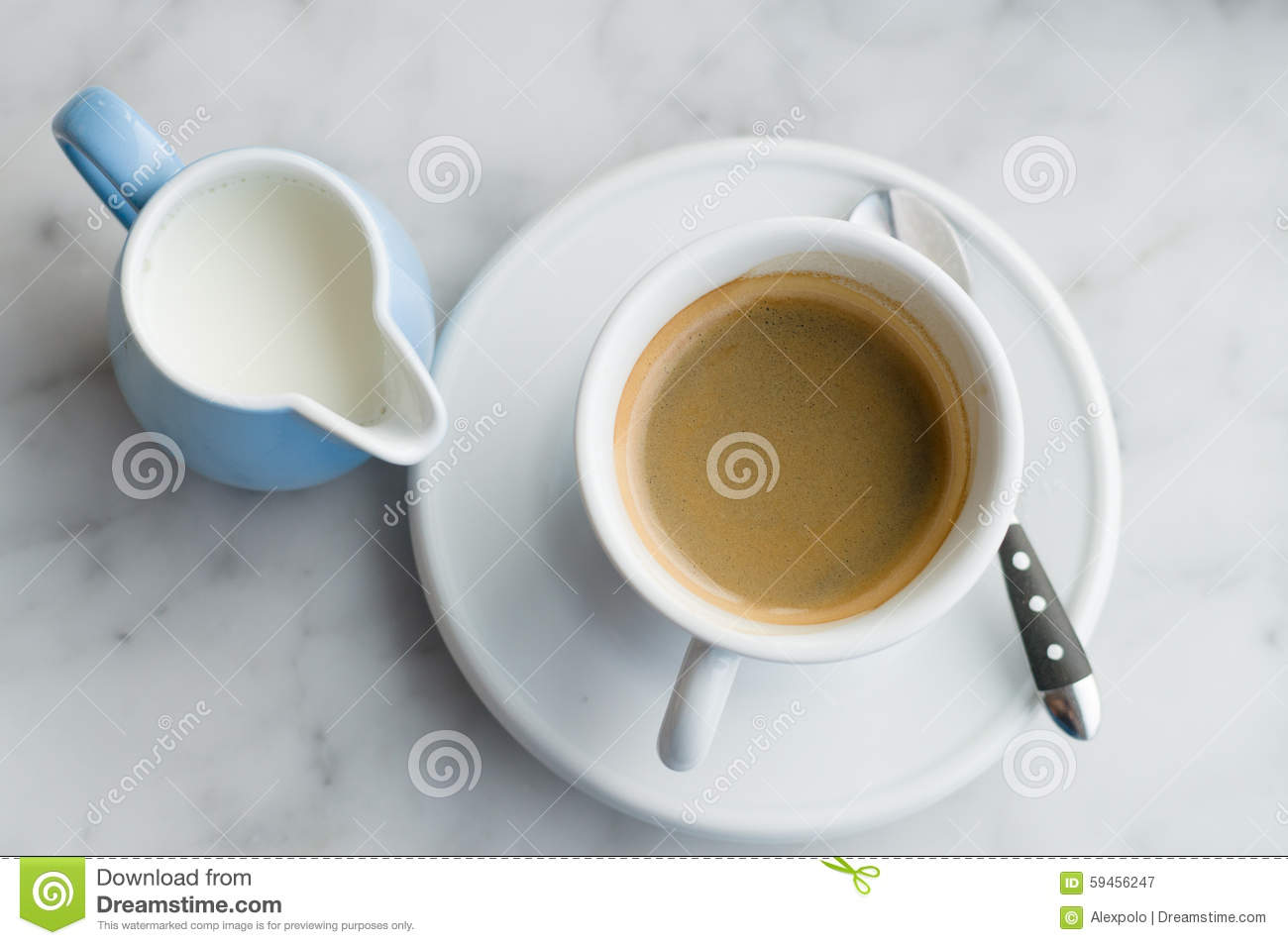 Cup of coffee and jug of milk