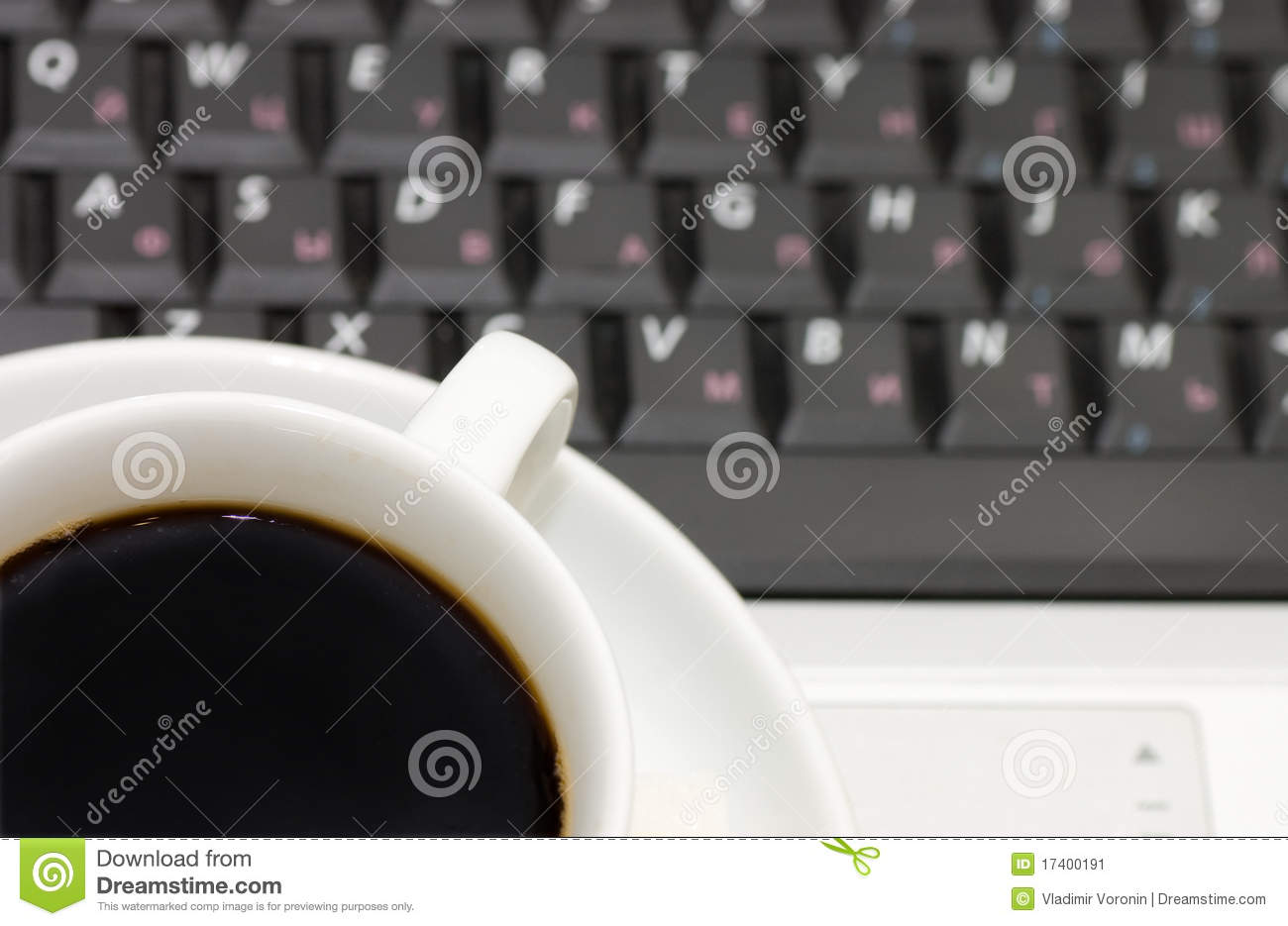 Cup from coffee on the laptop