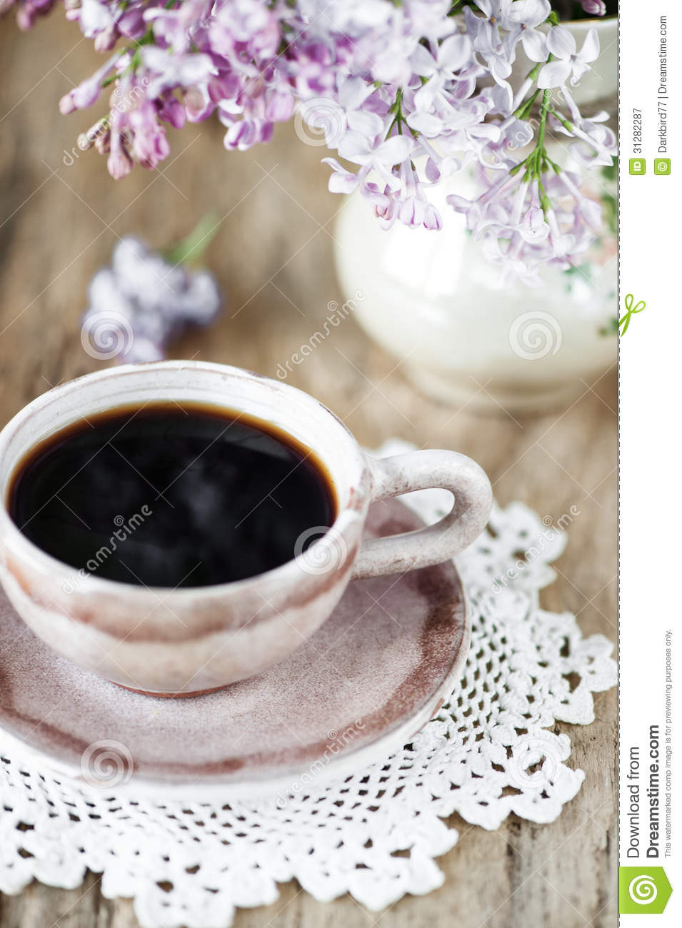 Cup Of Coffee And Lilac Flowers Bouquet Stock Image