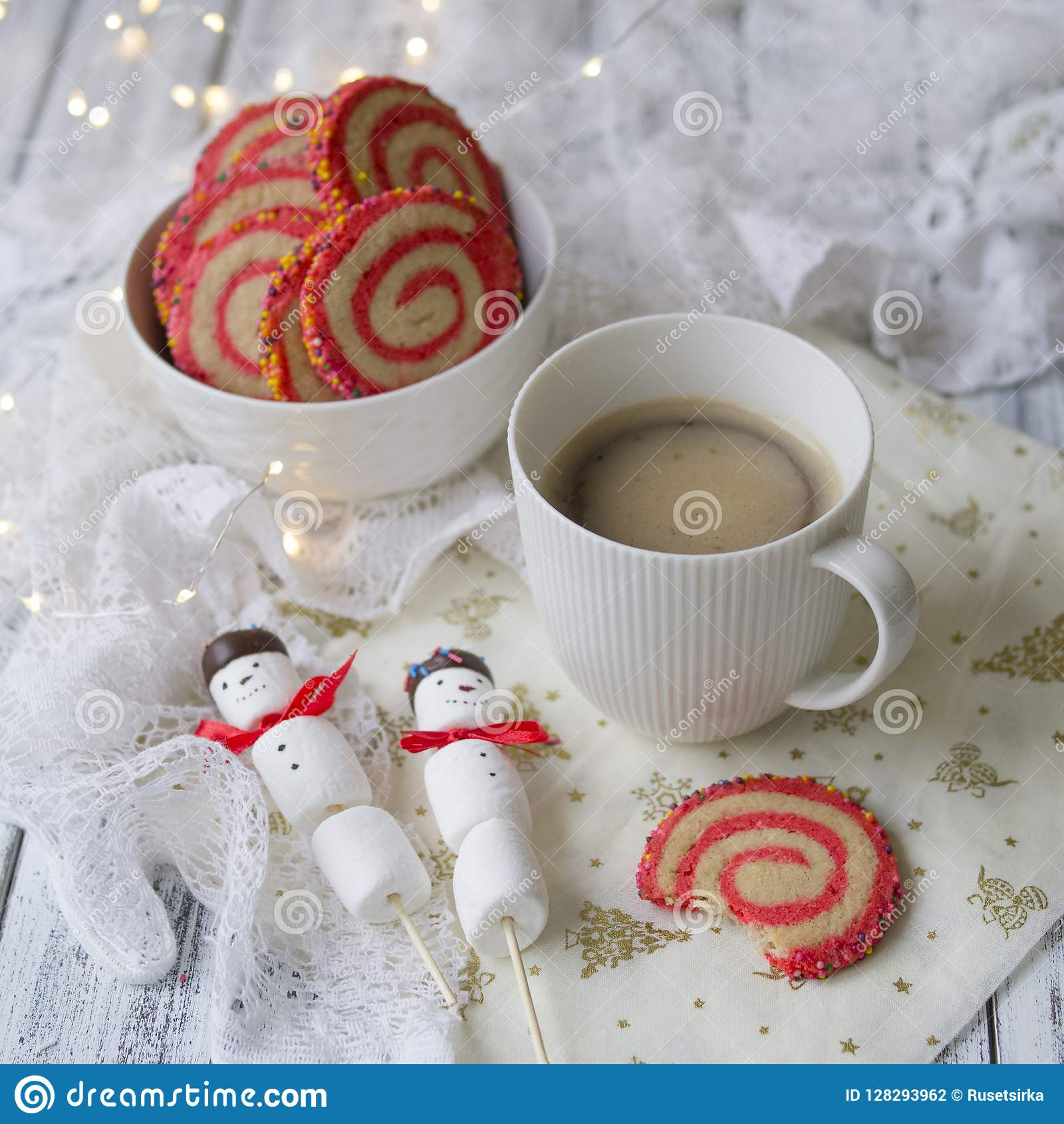 Cup Of Coffee With A Marshmallow Snowman And Cookies In The Form Of